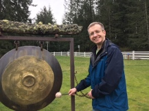 Nate banging a gong at the sculpture garden on Friday Harbor