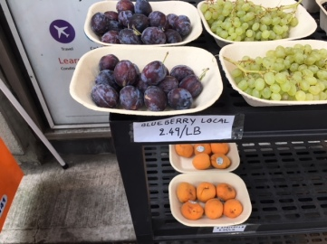 "Fresh fruit and ""blueberries"" outside of a market downtown. Photo by Cecilia Kennedy"