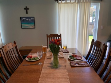 The table is set, with Nate's painting in the background, and a cross we bought for Christmas a couple of years ago. The painting is one Nate did when he returned from the Fiji Islands as a Peace Corps member.